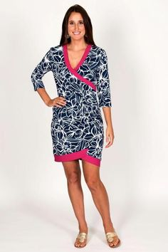 Floral Faux Wrap Dress ($150)Tracy Negoshian does it again! This faux wrap dress in classic navy and white floral pattern has a pop of color with pink trim on the collar and hemline. The dress is slightly fitted at the waist for a flattering fit. The material will stand up to a full day of meetings and still have you looking fabulous for happy hour or an after hours event.