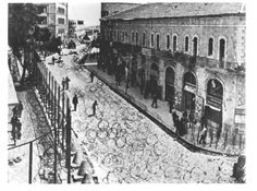 The British Entrapped | Before Their Diaspora.  Barbed wire and other barriers put up by the British around their administrative compound (left) in central Jerusalem, for protection against acts of terrorism by Zionist groups, fall 1947.