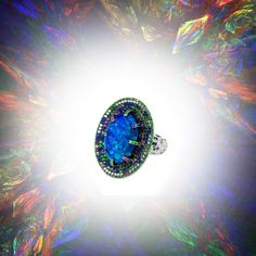 Martin Katz Opal ring with diamonds and gemstones set in white gold