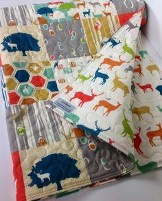 Hey, I found this really awesome Etsy listing at http://www.etsy.com/listing/154566213/organic-baby-boy-quilt-elk-grove