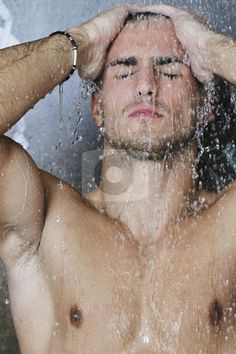 good looking men | Good looking man under man shower stock photo, Young good looking and ...
