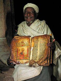 Ehiopian Coptic Christian priest with old manuscript