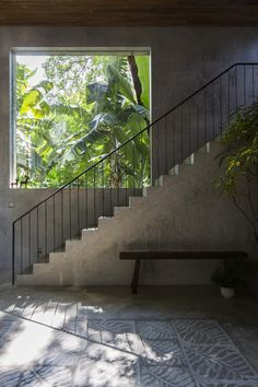 High ceiling space with concrete stairs beside a large fixed window. In the project Thong House in Ho Chi Minh, Vietnam, designed by NISHIZAWAARCHITECTS. Photographed by Decon Photo Studio. Contemporary Architecture, Architecture Details, Interior Architecture, Exterior Design, Interior And Exterior, Estilo Tropical, Stair Handrail, Railings, Concrete Stairs