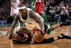 Boston, MA - 3/20/2017 - (4th quarter) Washington Wizards forward Kelly Oubre Jr. (12) and Boston Celtics guard Isaiah Thomas (4) dive for a loose ball during the fourth quarter. The Boston Celtics host the Washington Wizards at TD Garden. - (Barry Chin/Globe Staff), Section: Sports, Reporter: Adam Himmelsbach, Topic: 21Celtics-Wizards, LOID: 8.3.1932802928.