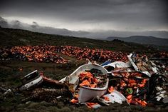 Wrecked boats and thousands of lifejackets used by refugees and migrants during their journey across the Aegean Sea lie in a dump in Mithimna, Greece