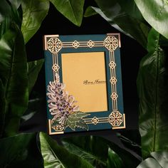 Misai Kuching Frame - Illustrated on Brunei's $500 bank note, the delicate white or purple coloured flowers of the Misai Kuching resembles the whiskers of a cat. Red garnets and rose quarts adorn the border of this teal coloured frame. #bruneigiftstotheworld #gifts #brunei #borneo #luxury #luxliving #luxurylifestyle #lifestyle #rainforest #decor #homedecor #prestige #flora #malaysiaroyalfamily #home #royalties #royal #craftsmanship #design #bruneiheritage #craftsmen #heritage