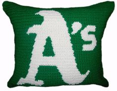 Baseball season is here and it's time to gear up and represent. Go A's!  I got a perfect decorative pillow for any Oakland A's fans.  A hand crocheted decorative throw pillow of the A's logo in white and green background. The back side can be either in ...