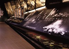 The National Holocaust Exhibition, Imperial War Museum, London. A great example of a timeline integrated with display cases and pop up graphics.