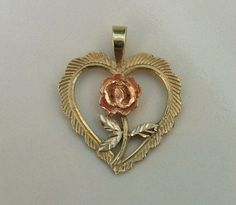 SALE...Vintage 14K Yellow , Rose  Gold   in shape of  a Heart with rose flower -Stunning