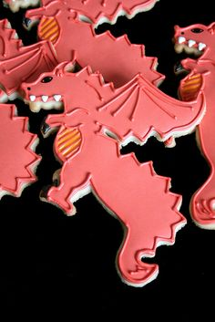dragon- less tail and pull the head back for a wooden figure! Royal Icing Cookies, Cupcake Cookies, Sugar Cookies, Dragon Birthday, Dragon Party, Kendall Birthday, Dragon Cookies, Empire Cookie, Viking Party