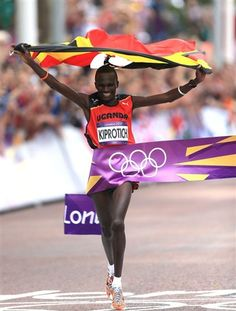 Uganda's Stephen Kiprotich crosses the line to win the men's marathon in London. (© PA Wire Press Association Images)