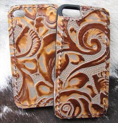 iPhone cases accented with leather by Running Roan Tack http://www.runningroantack.com/phonecovers.html