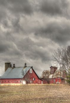 Weathered Red Barns & Storm Clouds