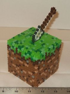 3D Minecraft design... looks like pony beads, but I like this idea for the cake.