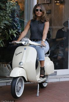Strike a pose: At one point Chloe could be seen posing on a vintage Vespa to complete her ...