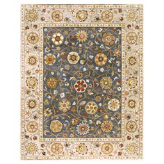 Wool rug with a floral motif and contrast border. Made in India.   Product: RugConstruction Material: Wool
