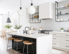 Love the simple elegance of this neutral kitchen by .jack Fantastic use of these black metal shelves that I have been dying to incorporate into a kitchen design. Küchen Design, Home Design, Layout Design, Design Shop, Creative Design, Living Room Kitchen, New Kitchen, Kitchen Decor, Living Rooms