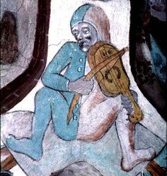 man in fool's costume (?) bowing stringed instrument (?gittern) -- detail of mural decoration in the church of Harkeberga, Uppland Sweden, painted in the 1480s and attributed to Albertus Pictor.