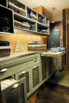 http://www.houzz.com/photos/5438246/Seifer-Laundry-Room-Ideas-craftsman-laundry-room-new-york Ventilated hampers on pull out drawers - AND slide out table top for folding