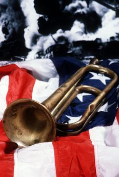 The bugle that was aboard the battleship USS ARIZONA (BB-39) on December 7, 1941, rests on the flag as a reminder of that fatal day at Pearl Harbor!