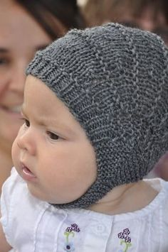 """Aviatrix is a fun, fast pattern for the cutest, best fitting baby helmet you will find. Worked on straight needles with instructions for 3 weights of yarn and 6 basic sizes this will become your """"go to"""" last minute baby hat pattern, unassuming when it comes off the needles it needs to be placed on a baby's head to reveal it's true potential!"""