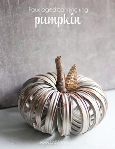 Pretty faux-aged canning ring pumpkin, fun fall home decor idea using canning rings. Recycling at its finest!!