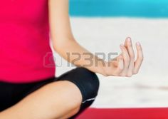 holidays, sport and yoga concept - girl sitting in lotus position and meditating Zdjęcie Seryjne - 22184176