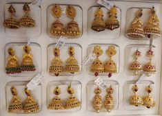 Stunning gold jumkhi collection from Jagadamba jewellers. Weighing approximately 15 to 35 grams of gold. Jumkhis studded with rubies and emeralds. Dubai Gold Jewelry, Ruby Jewelry, Gold Jewellery Design, India Jewelry, Gold Jhumka Earrings, Gold Bridal Earrings, Gold Earrings Designs, Gold Jewelry Simple, Hyderabad