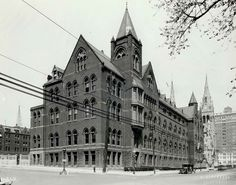 This Day in St. Louis History: July 31, 1888 St. Louis University moves to Grand Avenue  For St. Louis University moving from its campus at Ninth and Washington was something it had long foreseen. Architect Thomas Waryng Walsh designed both of the school's new buildings, the English Gothic-style university building (DuBourg Hall) and College Church (St. Francis Xavier). On July 31, 1888, SLU formally opened on the grounds it occupies today.