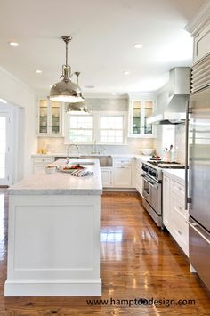 hardwood flooring + white marble kitchen