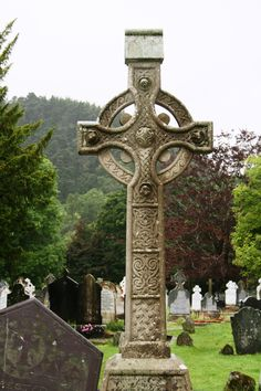 Day 3- This is the Celtic Cross headstone of Alice Mary and John James Cowley in St. Kevin's Cemetery to the right of the Round Tower in Glendalough, Ireland.