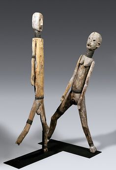 Pair of Figures, Sukuma Wood, metal, animal teeth, pigment, paint, 147.3cm, 170.1cm Private collection - QCC Art Gallery