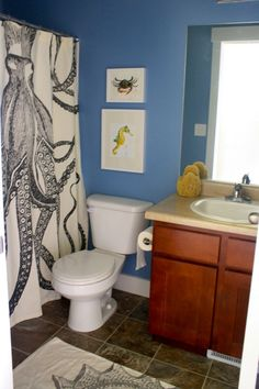 Amazing Paint Ideas With Blue Wall And Granite Tile Floor Plus White Toilet And Wooden Cabinet Also Unique White Curtain Artistic of Fancy Design Small Bathroom Color Ideas from Bathroom Ideas