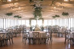 Sweetgrass Social wedding at Middleton Place. Whitney & Trey. Wedding reception space with greenery hanging from the ceiling.