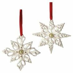"Handmade shell-inspired snowflake ornaments with faux pearl and glitter accents.  Product: 6 OrnamentsConstruction Material: ResinColor: WhiteFeatures:  Three of each designIncludes red velvet ribbon Dimensions: 4"" H x 4"" W each"