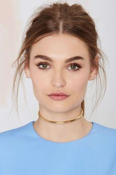 A gold minimal choker is perfect worn alone, or great with delicate layered chains | The Majestic Choker in Gold
