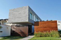 Ein modernes Haus mitten in der Stadt, das Platz und Privatsphäre gleichermaßen bietet und in dem Design, Funktion und Komfort Hand in Hand gehen ...