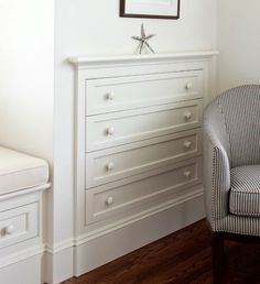 Built-in clothing storage is a no brainer, because it saves valuable floor space in your bedroom. This clever organizer has just as much room as a standalone piece, but leaves space for a pretty striped chair, too. Click for more genius home organizing ideas.
