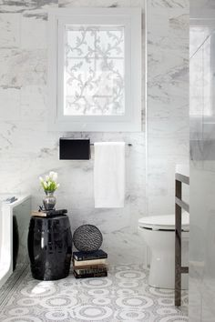 White marble with cool tile floor and black accents...