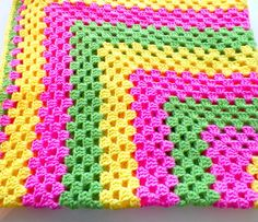 This Beautiful spring color blanket is very sweet and cute for any one trim in yellow.    Color - spring Green, yellow, pink    Size 40 x 40