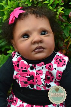 "ARIAH is a sweet little toddler baby that I created as a custom order from Jessica Schenk's ""Rowan"" sculpt. She is 24"" tall and has chocolate brown German glass eyes and dark brown hand-rooted Delta Dawn curls. Little Ariah lives in NEW YORK, USA.  See her at www.heartstringsnursery.com."