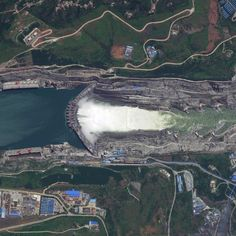 10/12/2015 Xiluodu Dam Xiloudu, China 28.259850000°, 103.649500000° Water from the Jinsha River surges through the Xiluodu Dam near Xiluodu, China. Arch dams like this one are designed so that the force of the contained water presses against the arch, compressing and strengthening the structure by pushing it into its foundation. At 937 feet (286 meters), the dam in Xiluodu is the fourth tallest in the world and is primarily used for hydroelectric power generation.