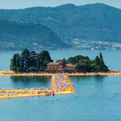 The Floating Piers on Lake Iseo, Italy. The lake is located 100 km east of Milan. These piers  were an art project and were free and open to the public only for 16 days. Those who tried to walk on the piers felt like walking either on the water or on a whales back.