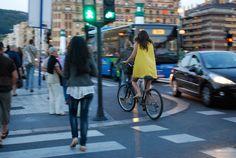 Bicycling yellow mini dress in San Sebastian, Spain