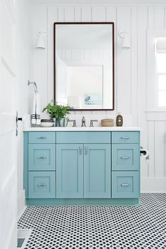 A big pop of color does wonders in any room, but especially in a tiny neutral space. We love all hues reminiscent of the sea, including the Green Blue paint by Farrow & Ball on this standout vanity.