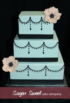 teal & black cake with a flower. Would also be cute in pink and black. One tier only. $50 for Buttercream. $65 for Fondant.