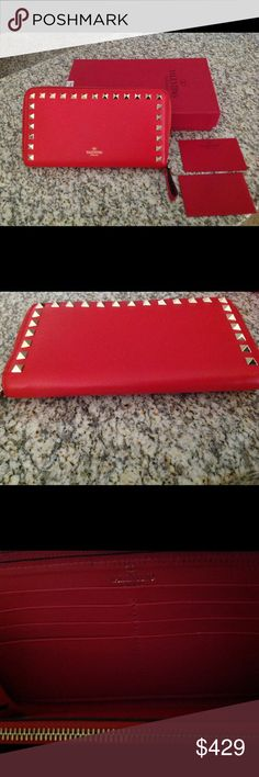 "Valentino Rockstud Wallet Authentic Valentino Rockstud zip around wallet. Very good Gently used preowned condition with minor wear (pilling) on zipper. 8"" wide and 4"" high. Comes with box and authenticity cards. Originally retailed for $695 and purchased directly from the Valentino store in South Coast Plaza. Valentino Bags Wallets"