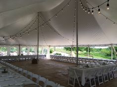 Rope and Pole tent with bistro lights. Contact ABC Rentals Special Events to get more information about renting a tent for your wedding or special event! #SiouxFallsWedding