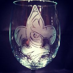 LSU Tigers fleur de lis handmade etched wine glass  $20.00  Check out this item in my Etsy shop https://www.etsy.com/listing/192068334/lsu-eye-of-the-tiger-fleur-de-lis-etched