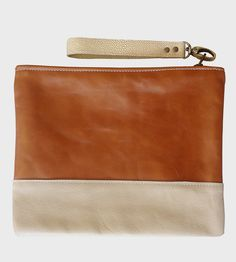 Leather Zipper Pouch | This handsome leather pouch is made with a minimum design and ... | Travel Pouches
